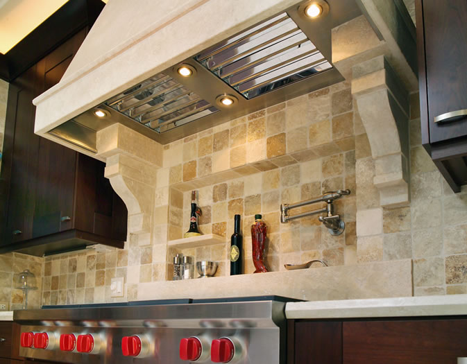 This custom limestone hood with commercial stainless liner integrates perfectly with the wall niche.