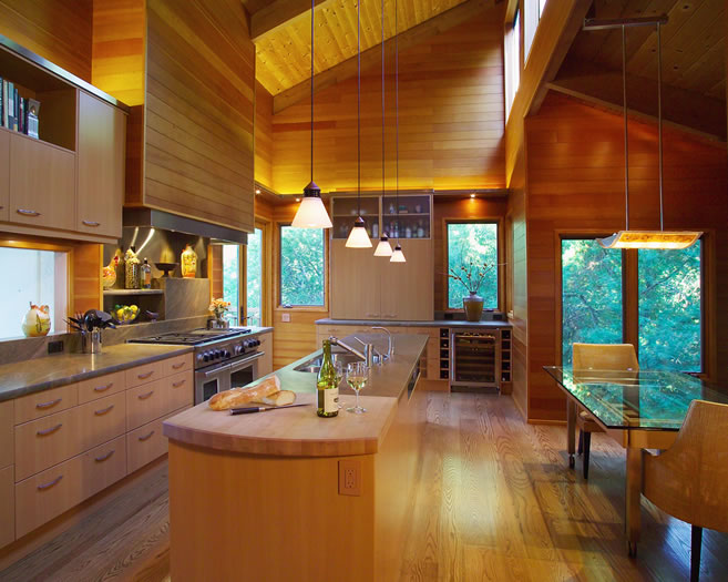 A butcher block prep area is integrated into the island design.
