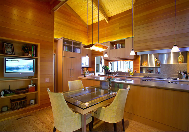 Honed granite counters and wood grained laminate cabinetry provide durability and beauty.