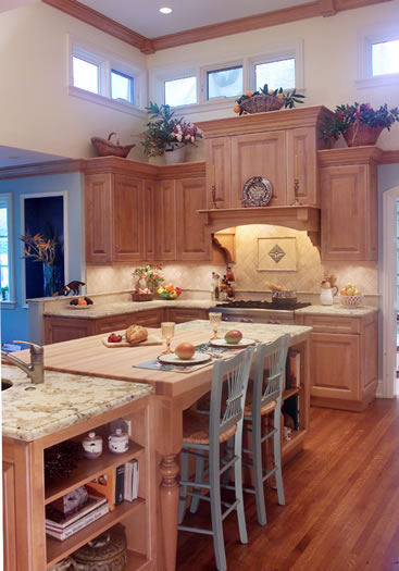 The multi purpose island is at the heart of this large kitchen.
