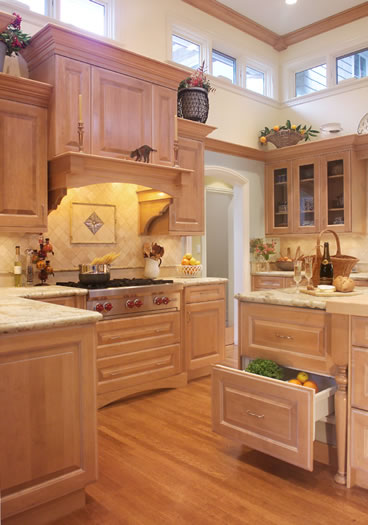 The custom cabinetry hood with tile backsplash is a focal point.