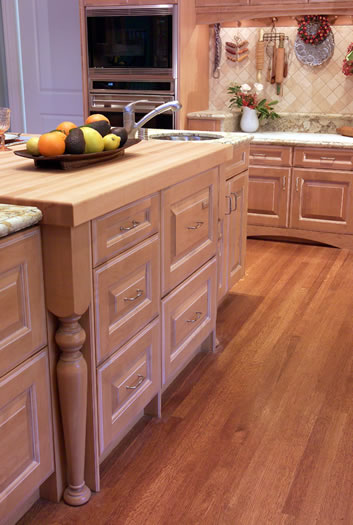 Dishwasher and refrigerator drawers are integrated into the island.