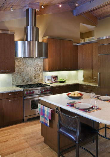 The custom stainless steel cabinetry crown and range hood make a strong statement.