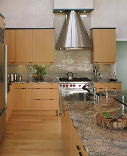 A clean look with granite counters, glass tile backsplash and stainless appliances.