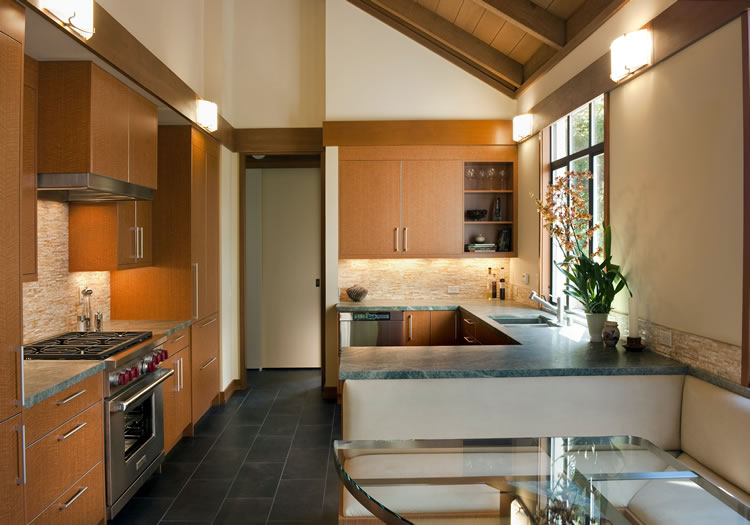 The wood grain laminate cabinetry doors have metal edge banding accents to match the hardware.
