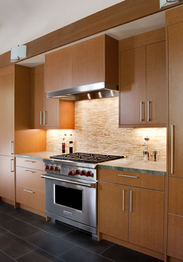 The split quartz tile splash gives a sharp contrast to the honed granite counters & modern cabinetry.