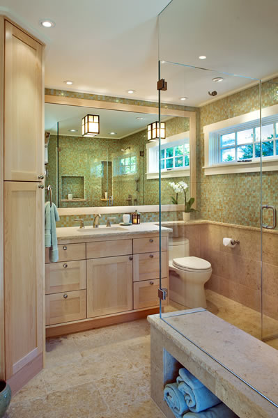 The chiseled edges of the limestone slabs create a nice counterpart to the clean lines of the maple cabinetry and glass tiles.