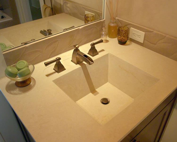 Custom limestone slab sink.