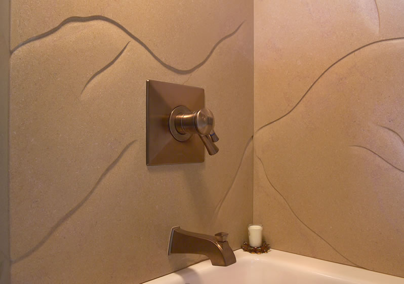 The limestone slab is hand carved with an organic pattern.