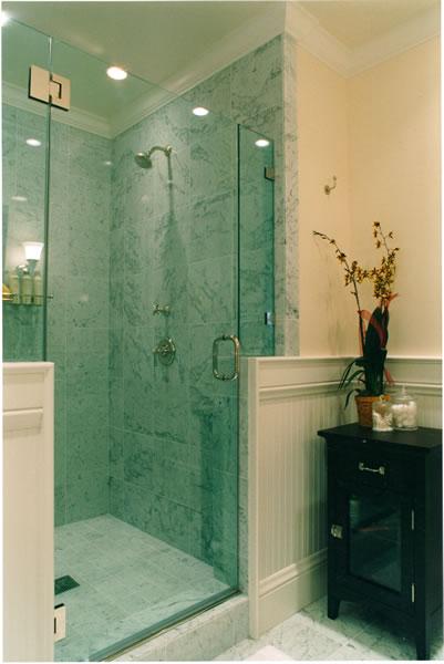 A Victorian bath with Carrara marble shower.