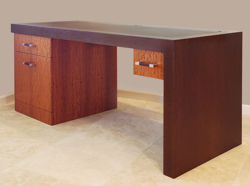 A contemporary desk with leather inlay.