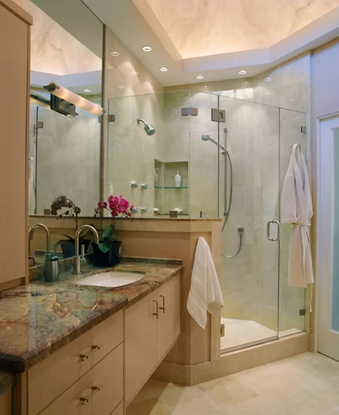 The colorful marble counter gives contrast to this bathroom.