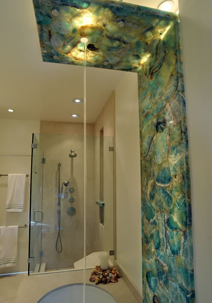 The clean look of limestone slabs are used for this shower and tub.