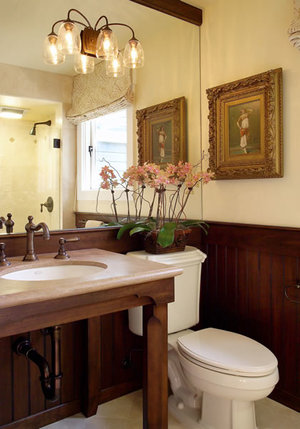 Rustic console table vanity with matching wainscot.