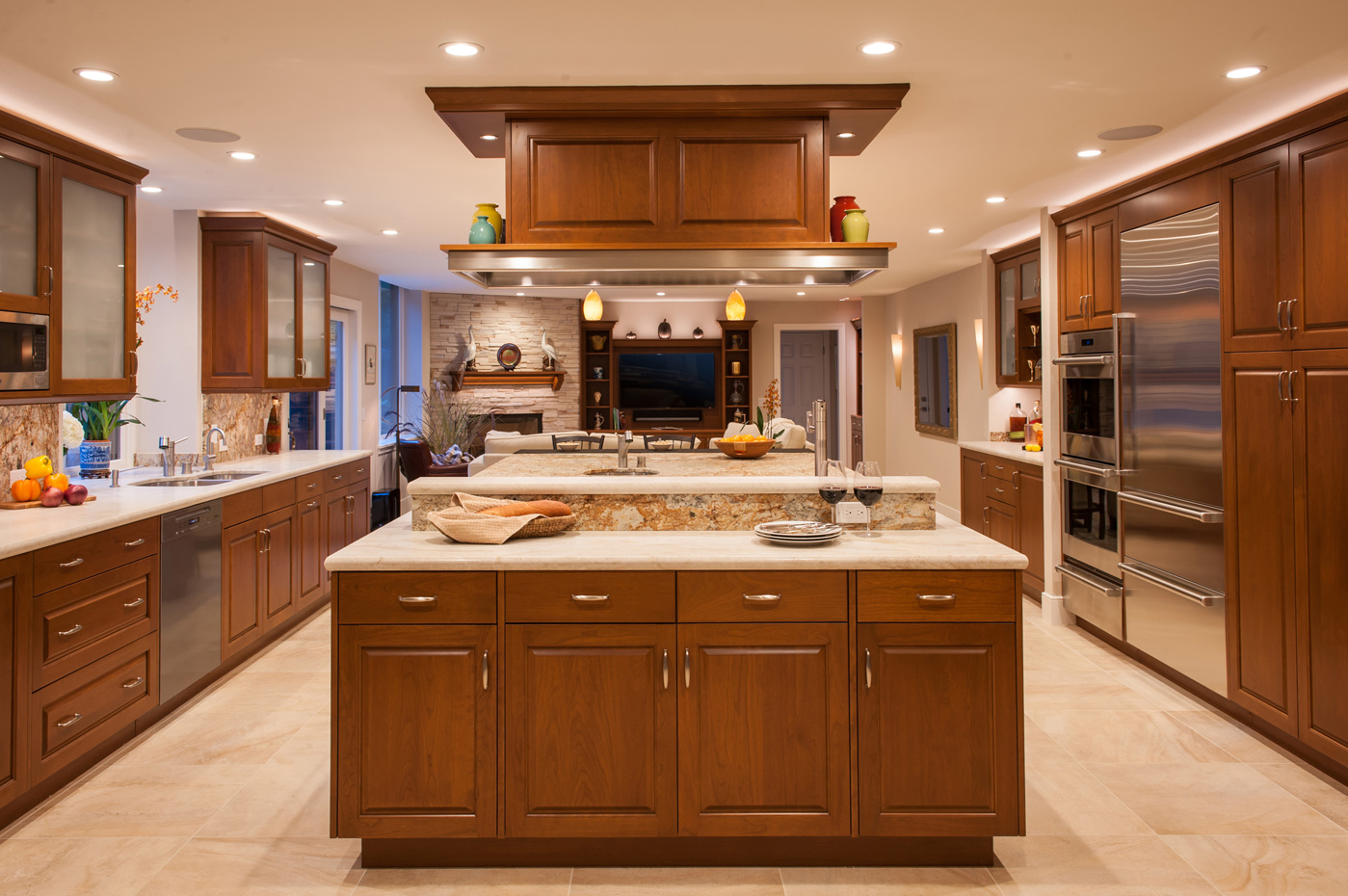The custom hood and cabinetry are cherry with stainless steel accents.
