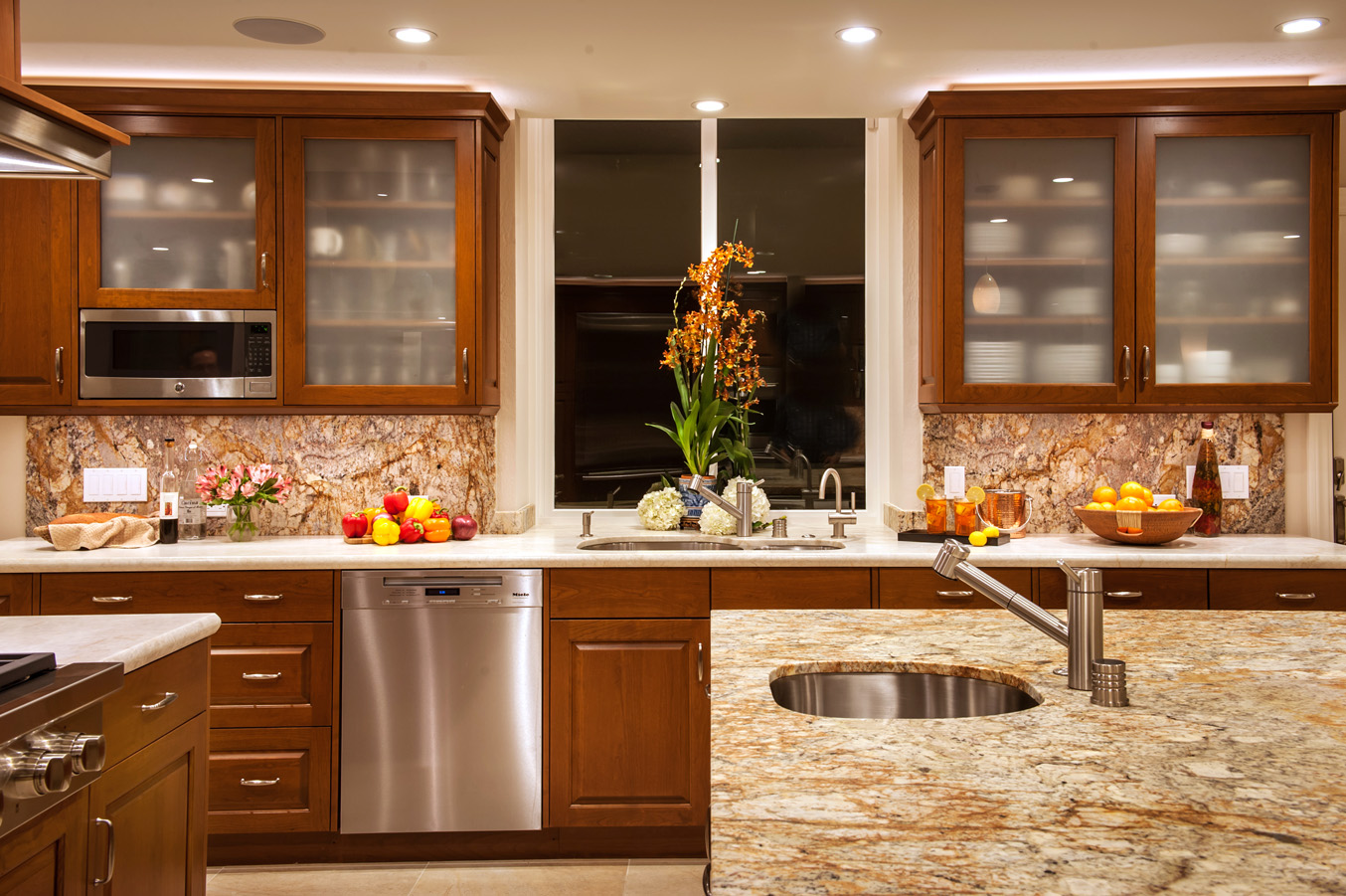 Contrasting granites are used on the counters and backsplashes.