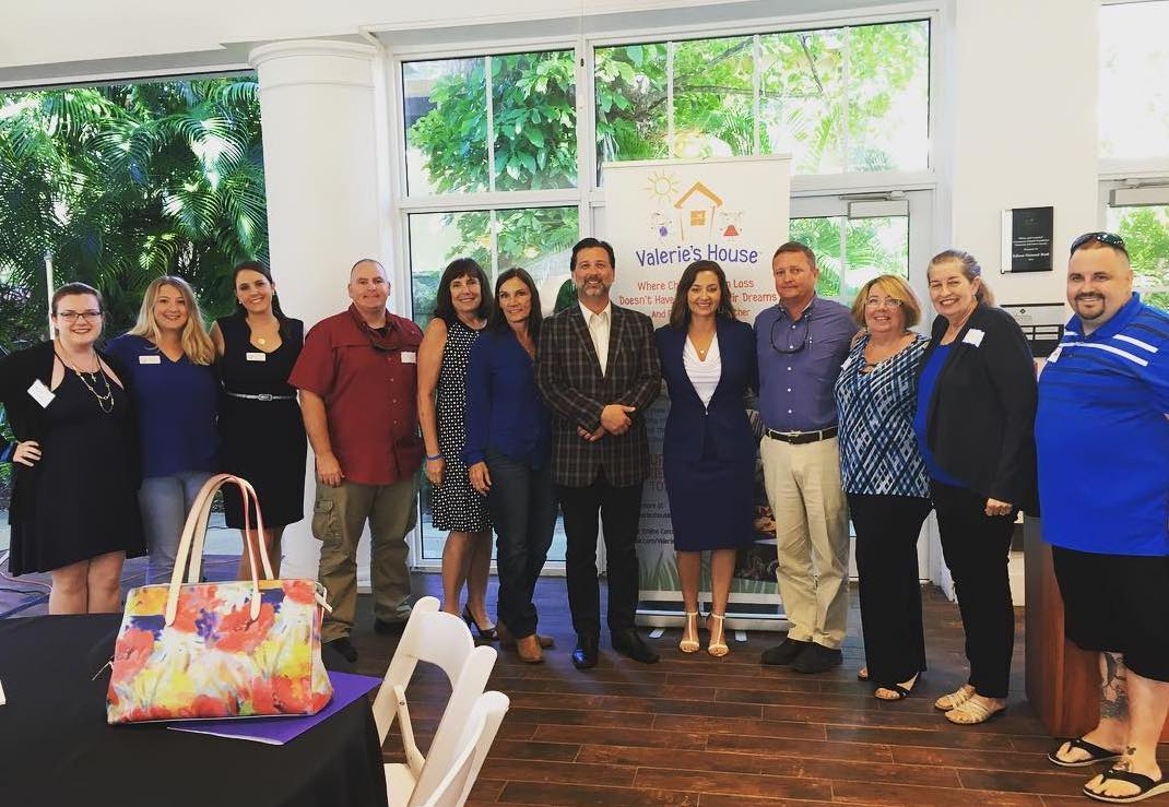 Valerie's House staff, volunteers, and families, with guest speaker Andy McNiel. Pictured left to right: Hayley Edwards, Allyson O'Brien, Danielle Visone, Shon Wells, Carol Gates, Roseanne Visone, Andy McNiel, Angela Melvin, Alton Green, Leslie Erschen, Barbara Bodenhamer, and Jeff Lampila