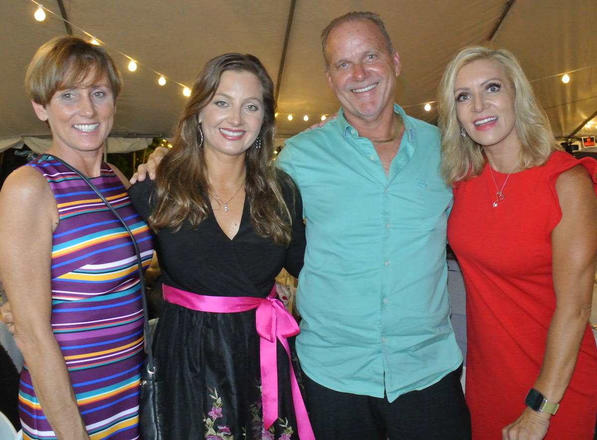 Pictured from left to right: Dawn Melvin, Angela Melvin (Valerie's House CEO), Keith Melvin, and Sunset Soirée Emcee, Krista Fogelsong at the 2018 Sunset Soirée to benefit children's grief support programs at Valerie's House.