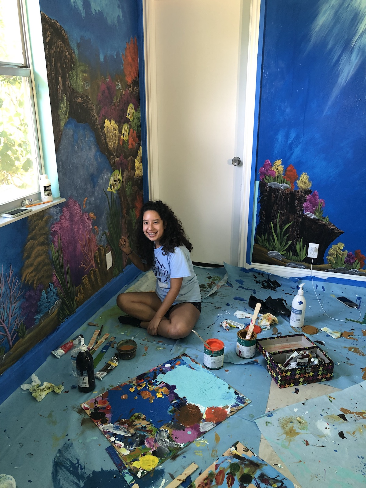"Barbara Del Castillo, 16, hopes her murals, like ""Magic Under the Sea"", will bring peace and calm to children in grief programs at Valerie's House in Naples."