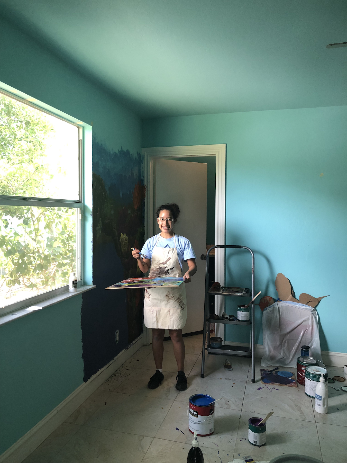 Barbara Del Castillo, 16, shared her talents painting murals at Valerie's House new home in Naples.