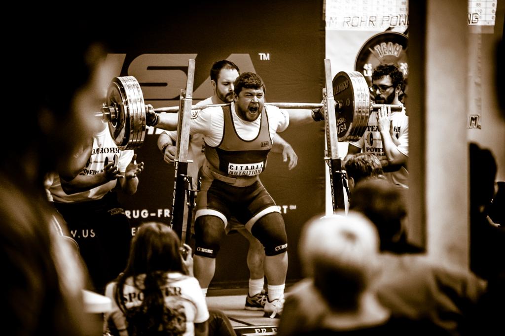 Citadel Nutrition Athlete Ross Tyner squatting 566#
