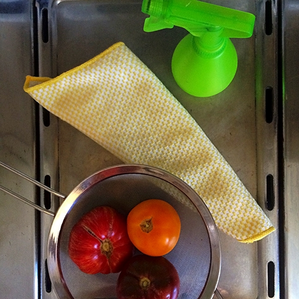 Let produce set with spray for 5 - 10 minutes and then wash or scrub off.