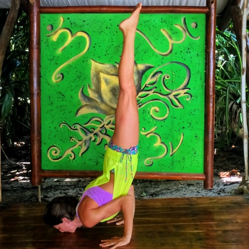 Go for symmetry when possible. I positioned the phone to capture the painting and my pose in a symmetrical way so it's more pleasing to the eye. Hotel Tropico Latino Yoga Deck, Santa Teresa, Costa. October 2015.