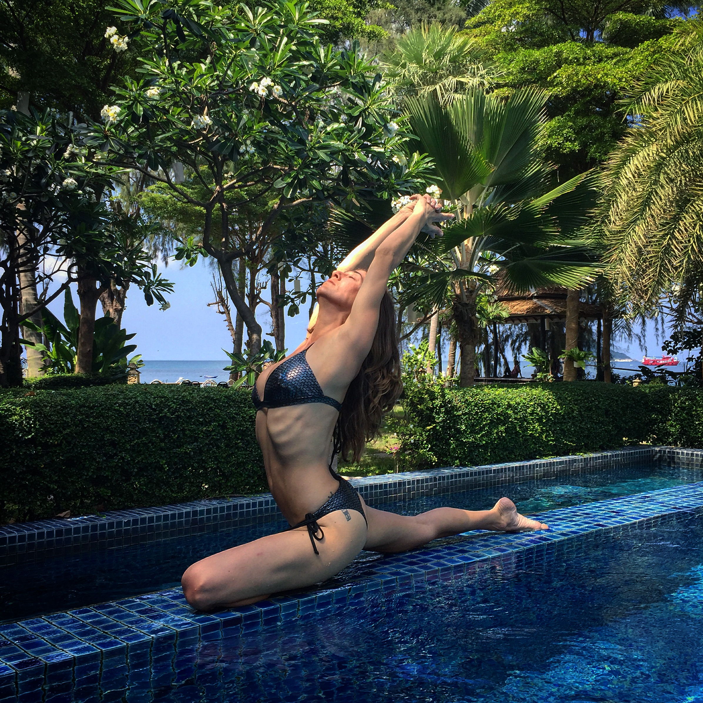 Practicing some yoga in the pool at Koh Tao Montra Resort.