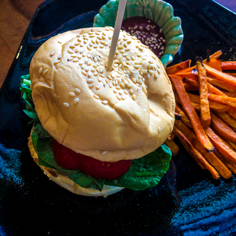Super Yogi Burger: we chose the smokey beans patty, bell pepper, spinach, the whole grain bun & the vegan mayo. Sweet potato fries on the side, of course!