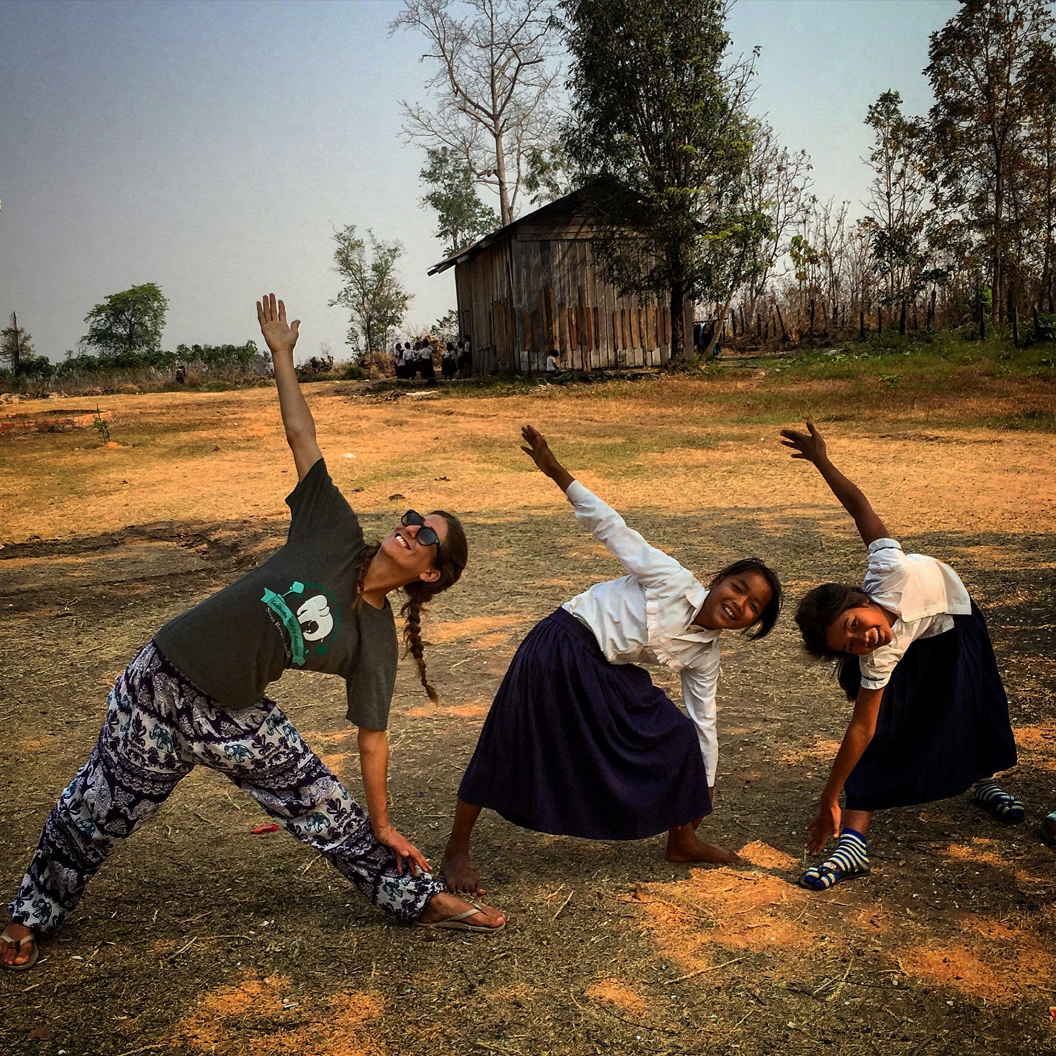 Teaching yoga to children in rural Cambodia.