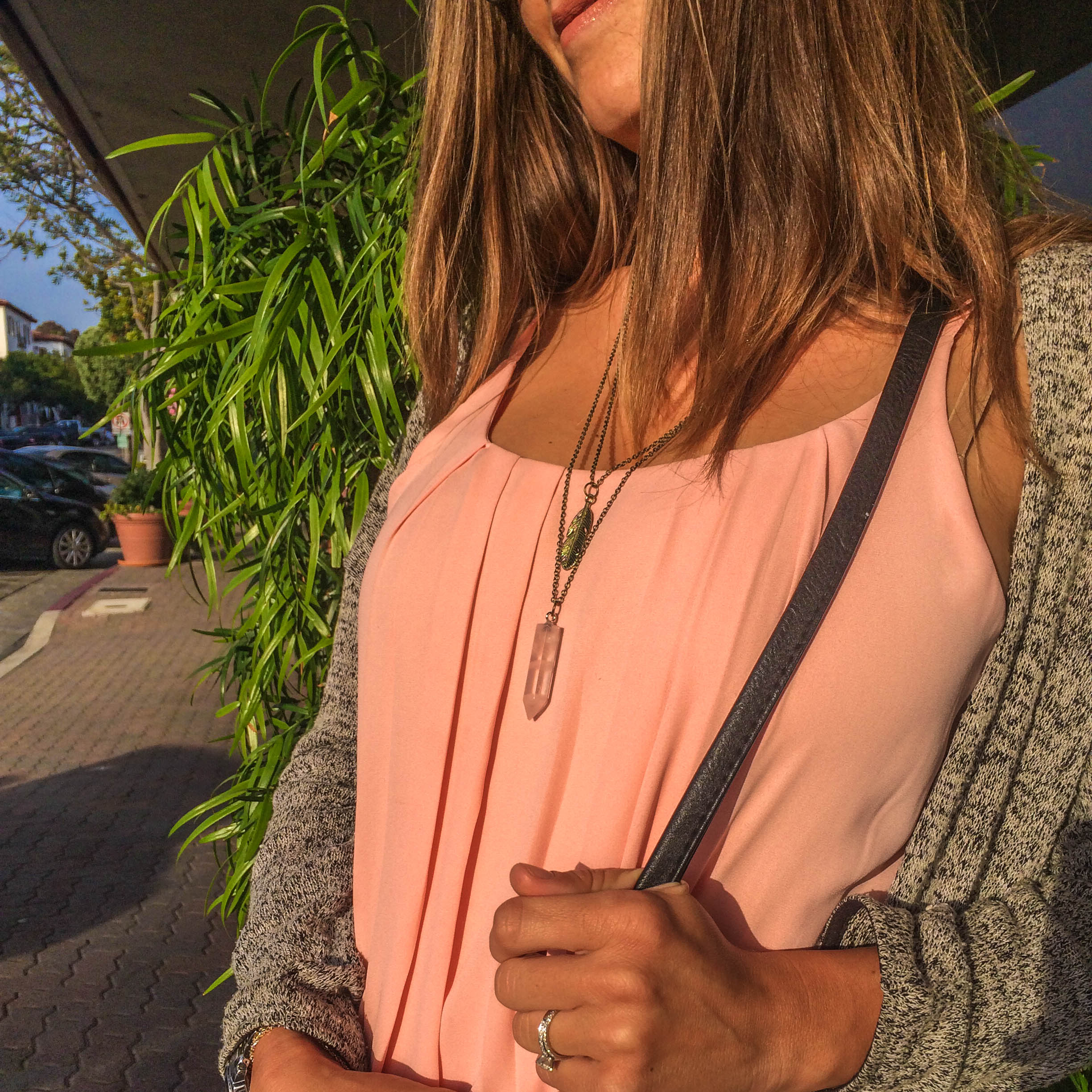 """Wearing the """"Feather Rose Quartz Point Pendant"""" from the  Yogi Surprise Jewelry Box ."""