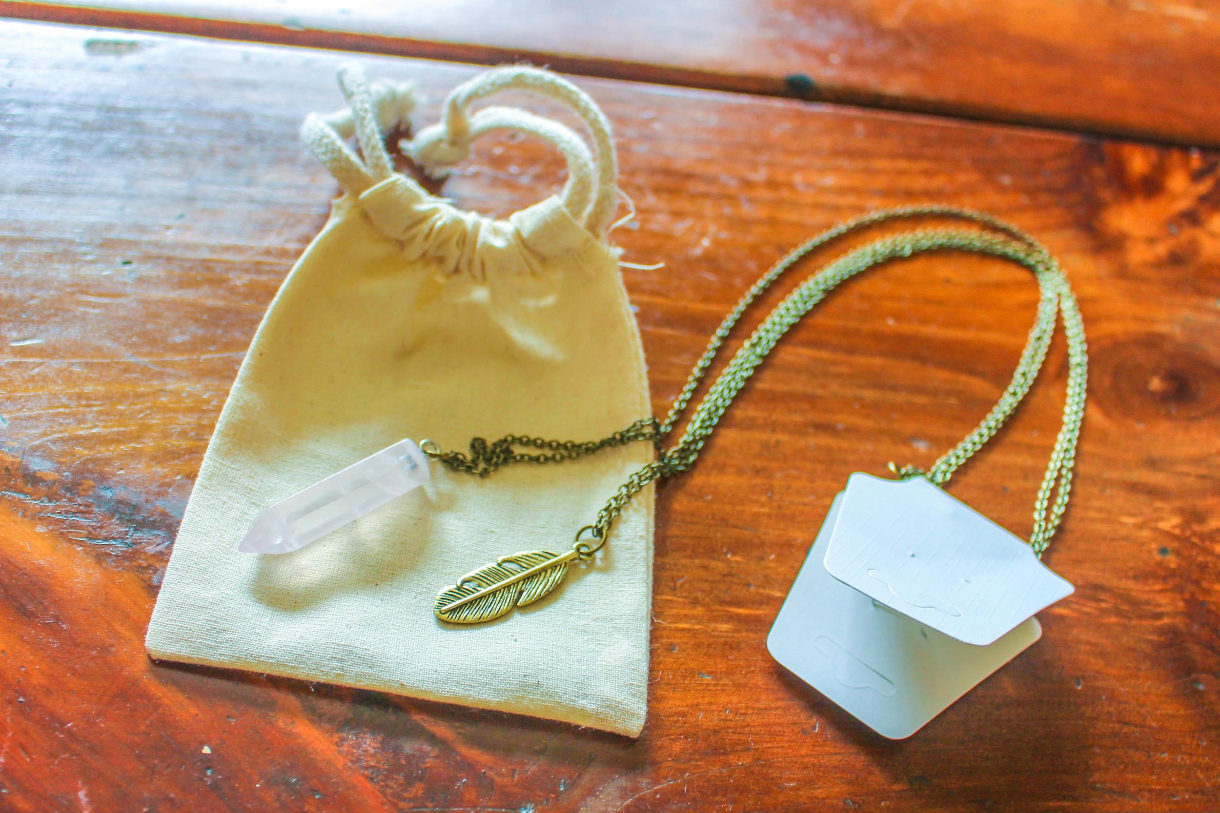 Feather Rose Quartz Point Pendant from the  Yogi Surprise Jewelry Box .