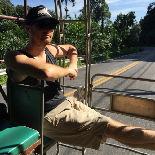 Pete on the taxi to meet the bus to Phuket.