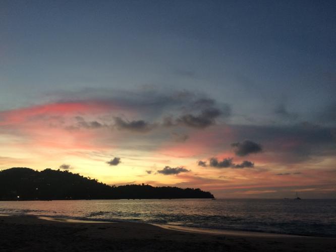 The sun sets over Bang Tao beach, Phuket.