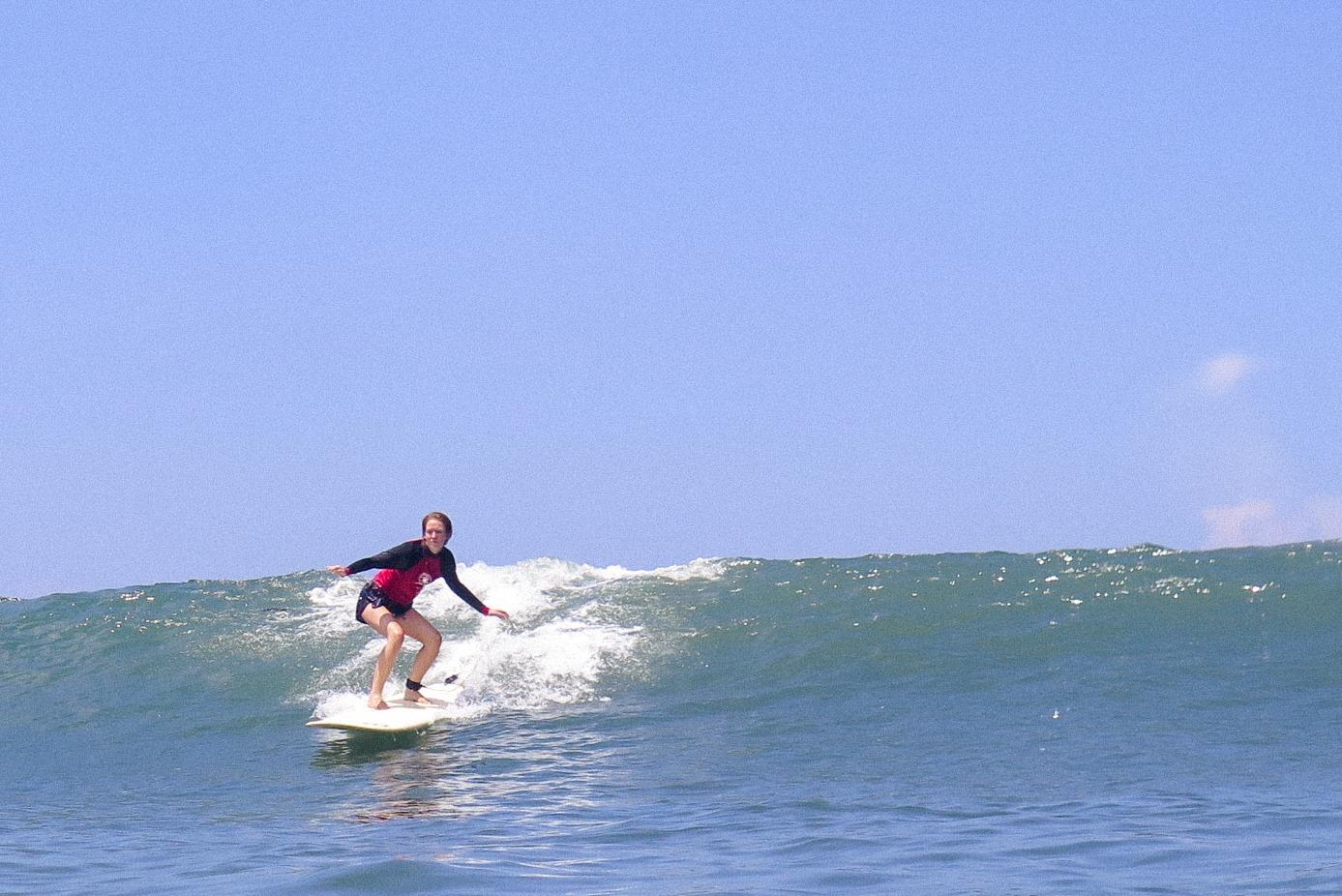 Katherine Plunkett catching a wave on the Serene Yoga Retreat in Canggu, Bali.