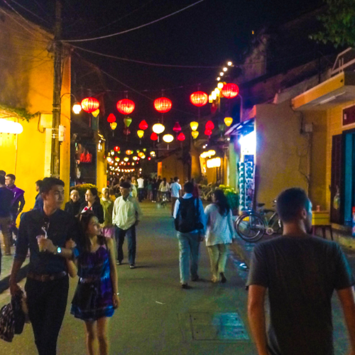 A street in Hội An at night.