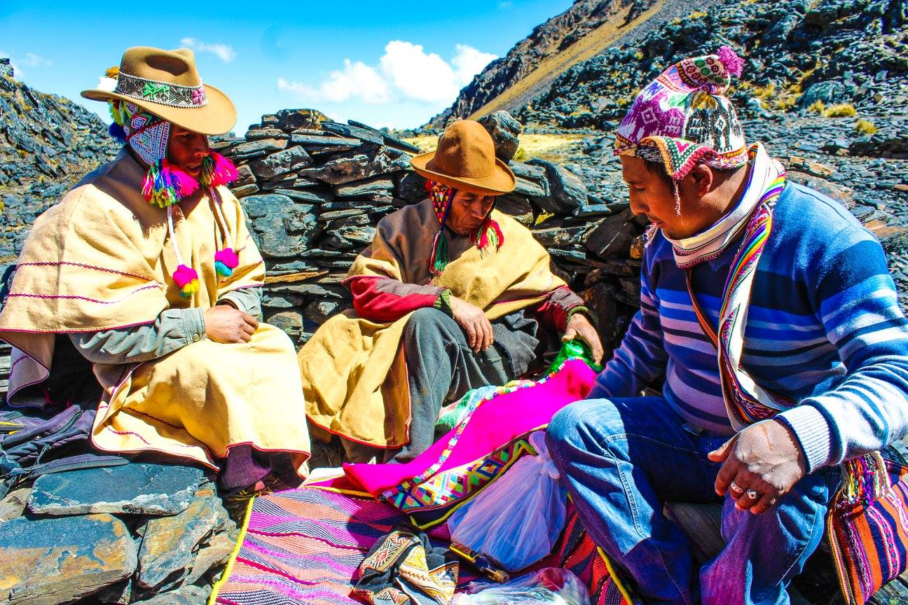 Q'eros men performing a despacho - or giving thanks to Pachamama.