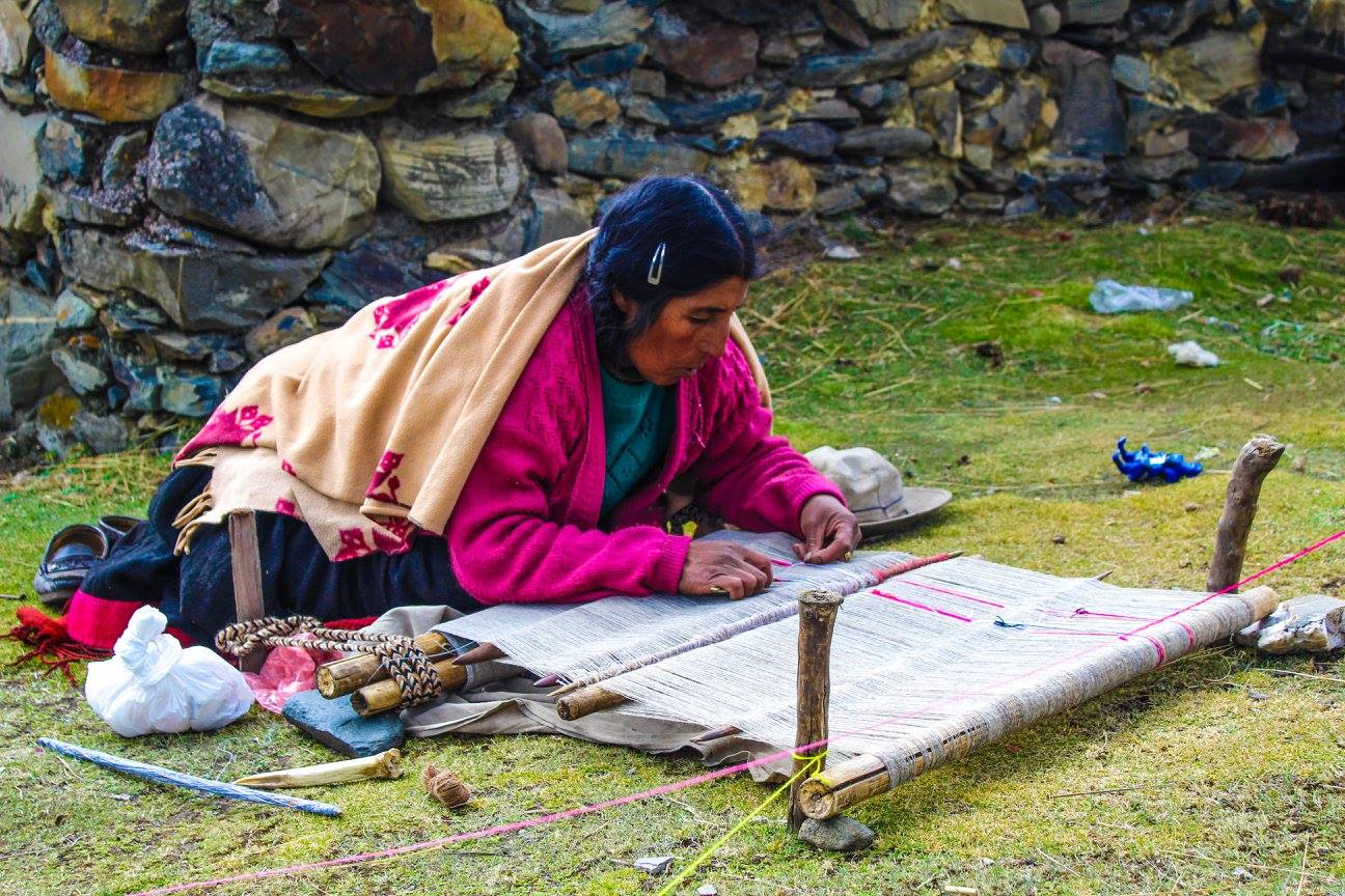 A Q'eros woman weaving in the traditional way.
