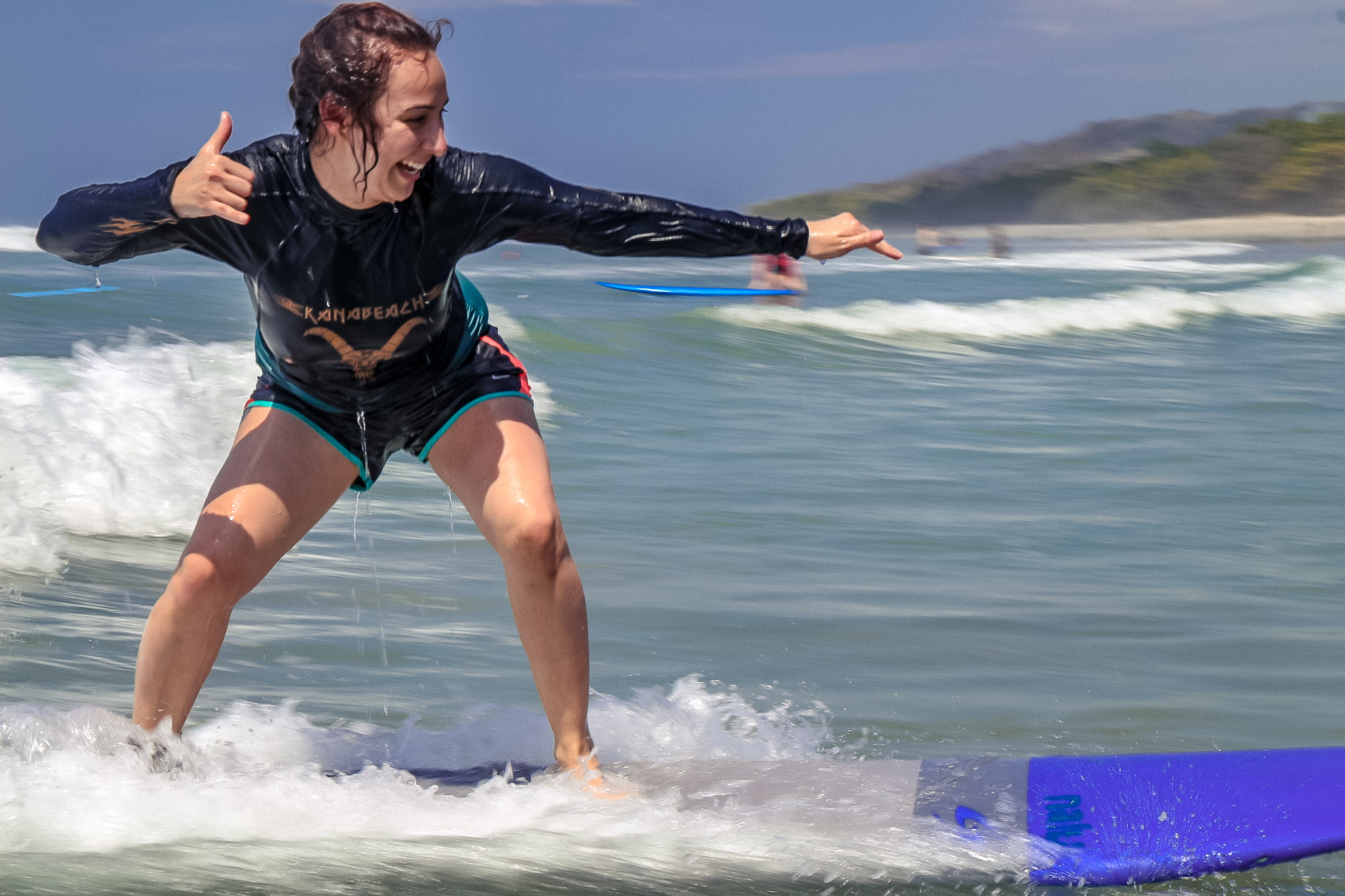 Jontea, our guest, catching waves on her first lesson in February 2019!