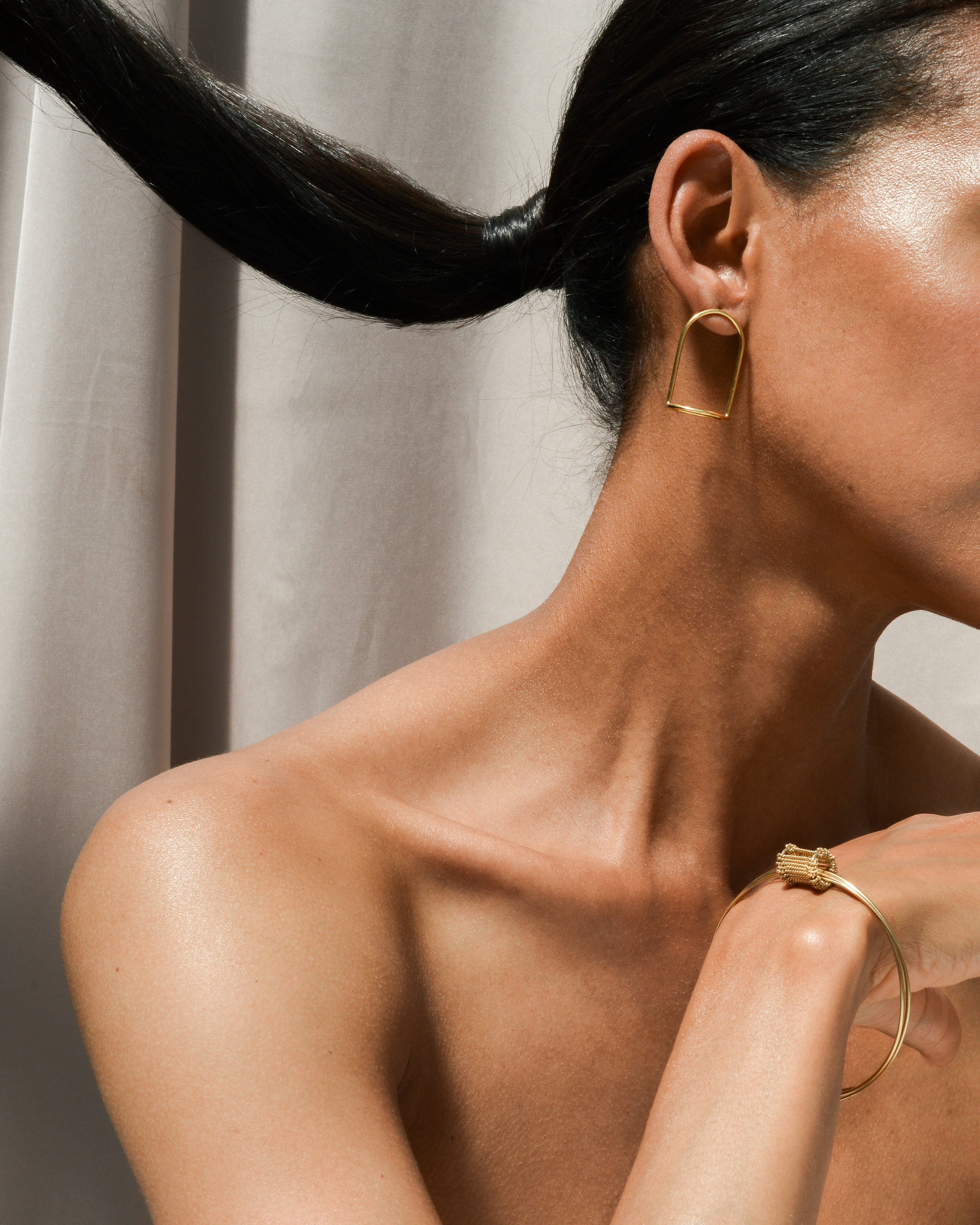 BELL JAR EARRINGS   & BANGLE in 18ct gold plated silver Photography -  Stark Studio  Model -  Dieny Itoe  MUA -  Shaun Lavender
