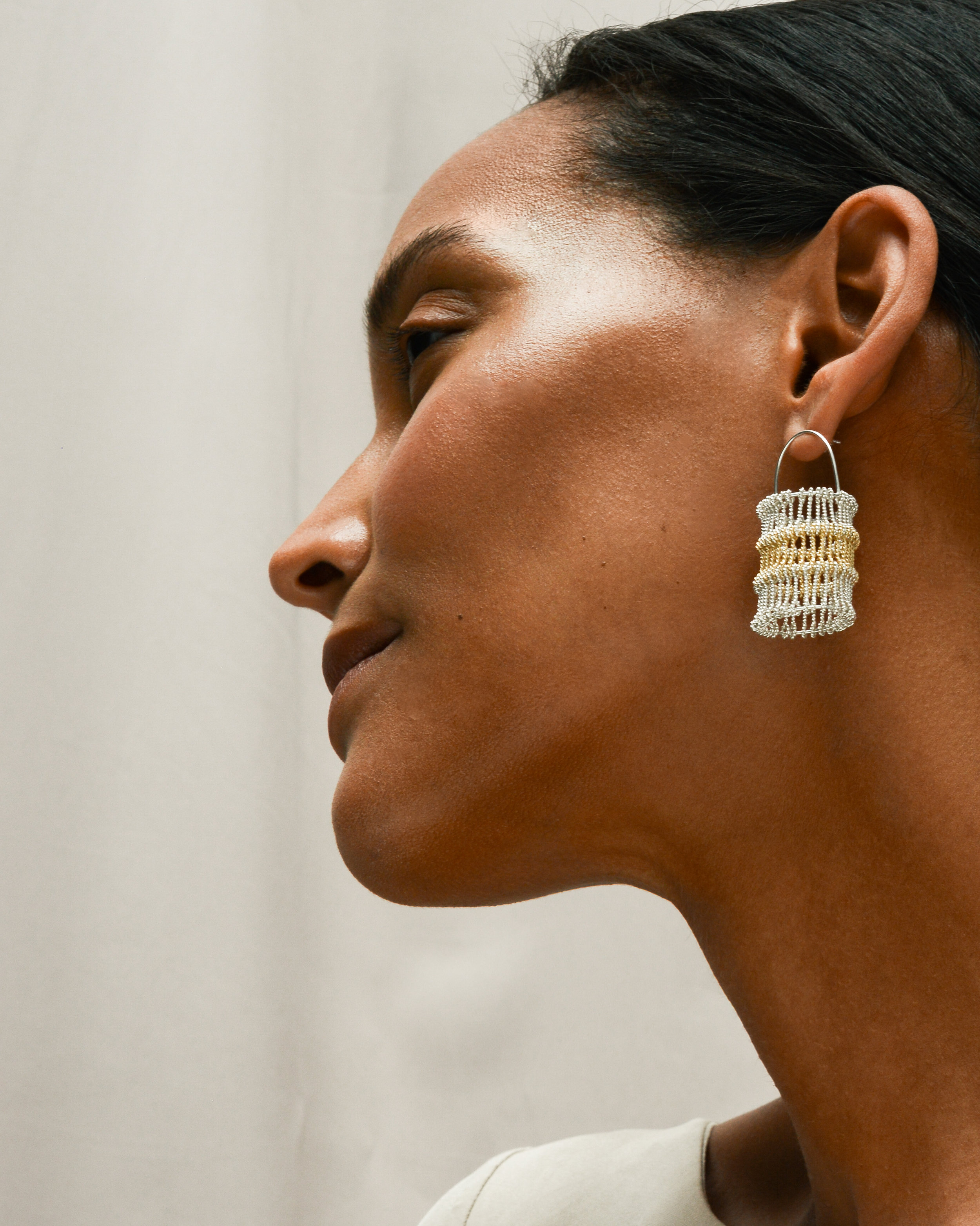 LEVEL HEDDLE EARRINGS  in 18ct gold and sterling silver Photography -  Stark Studio  Model -  Dieny Itoe  MUA -  Shaun Lavender