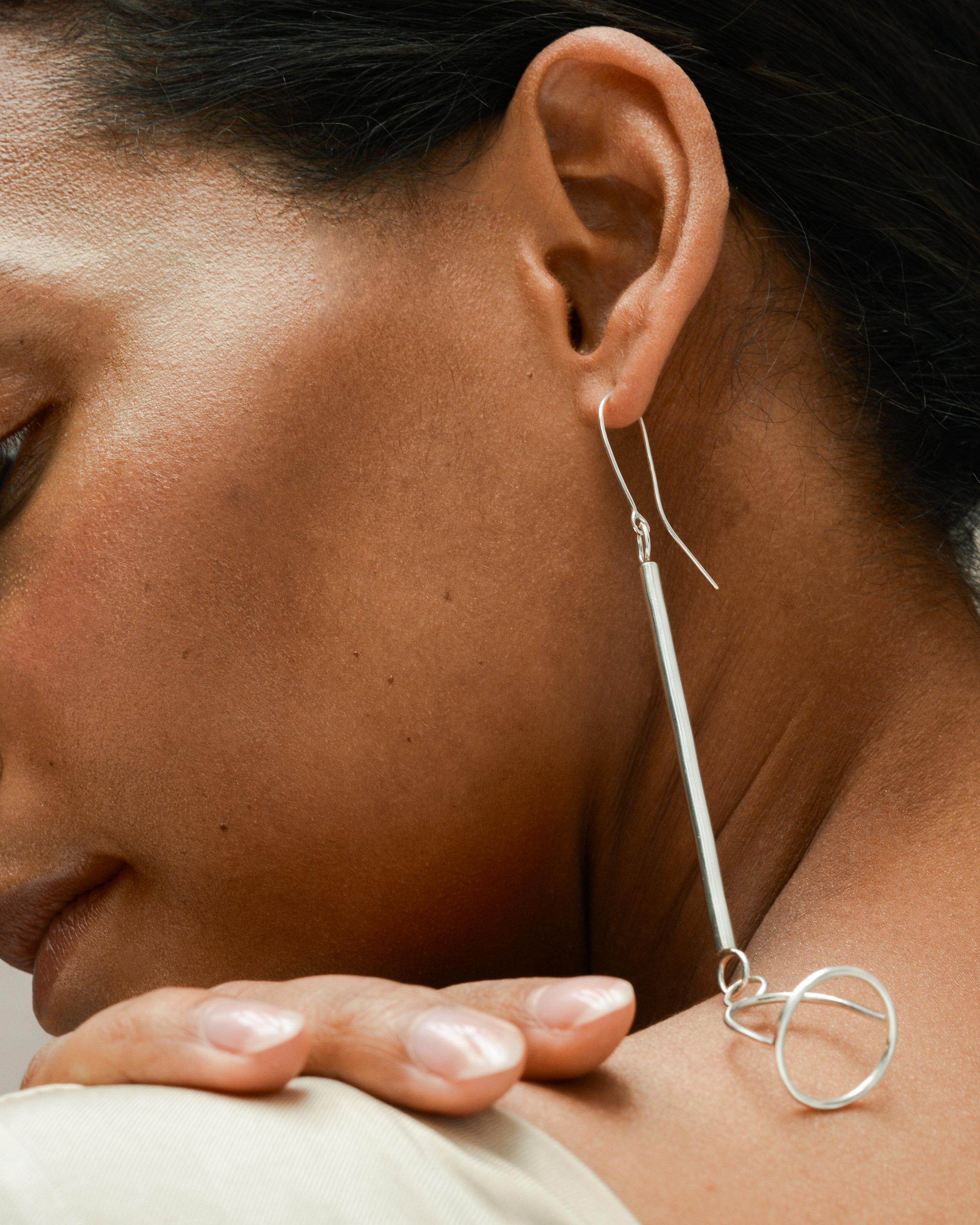 BELL DROP EARRINGS  in sterling silver Photography -  Stark Studio  Model -  Dieny Itoe  MUA -  Shaun Lavender