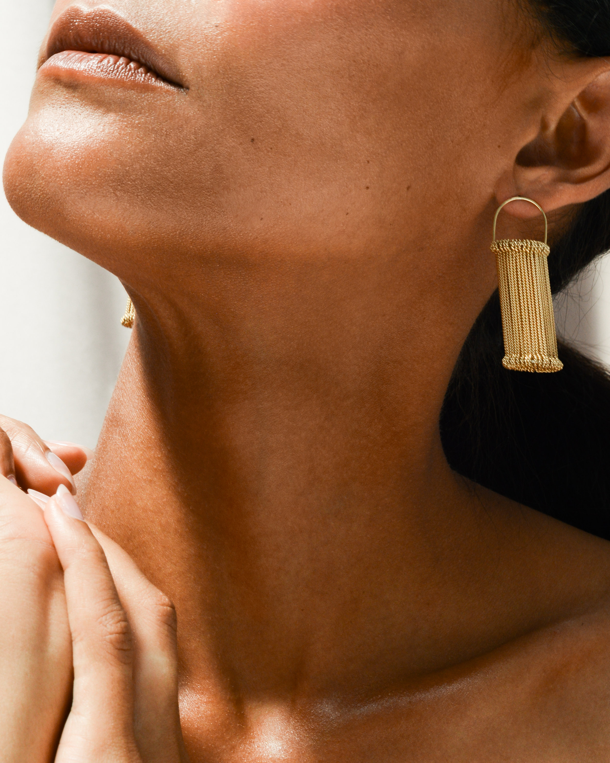 HEDDLE EARRINGS  in 18ct gold plated silver Photography -  Stark Studio  Model -  Dieny Itoe  MUA -  Shaun Lavender