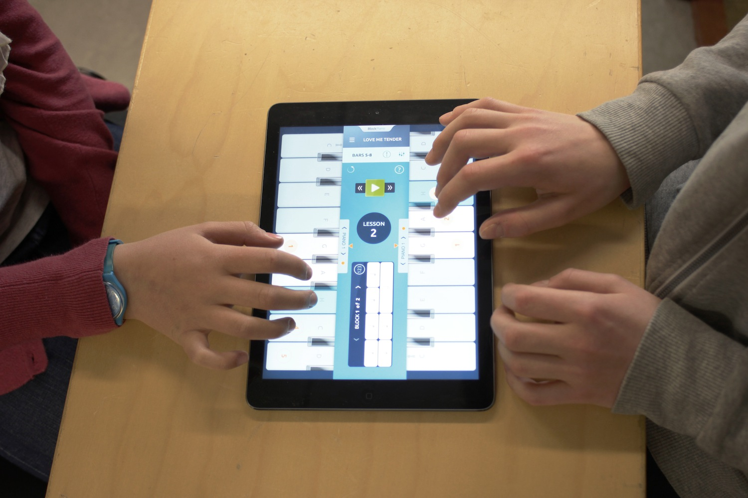 Learn to play the piano on your ipad. With BlockPiano piano lessons one to three persons can play on one iPad.