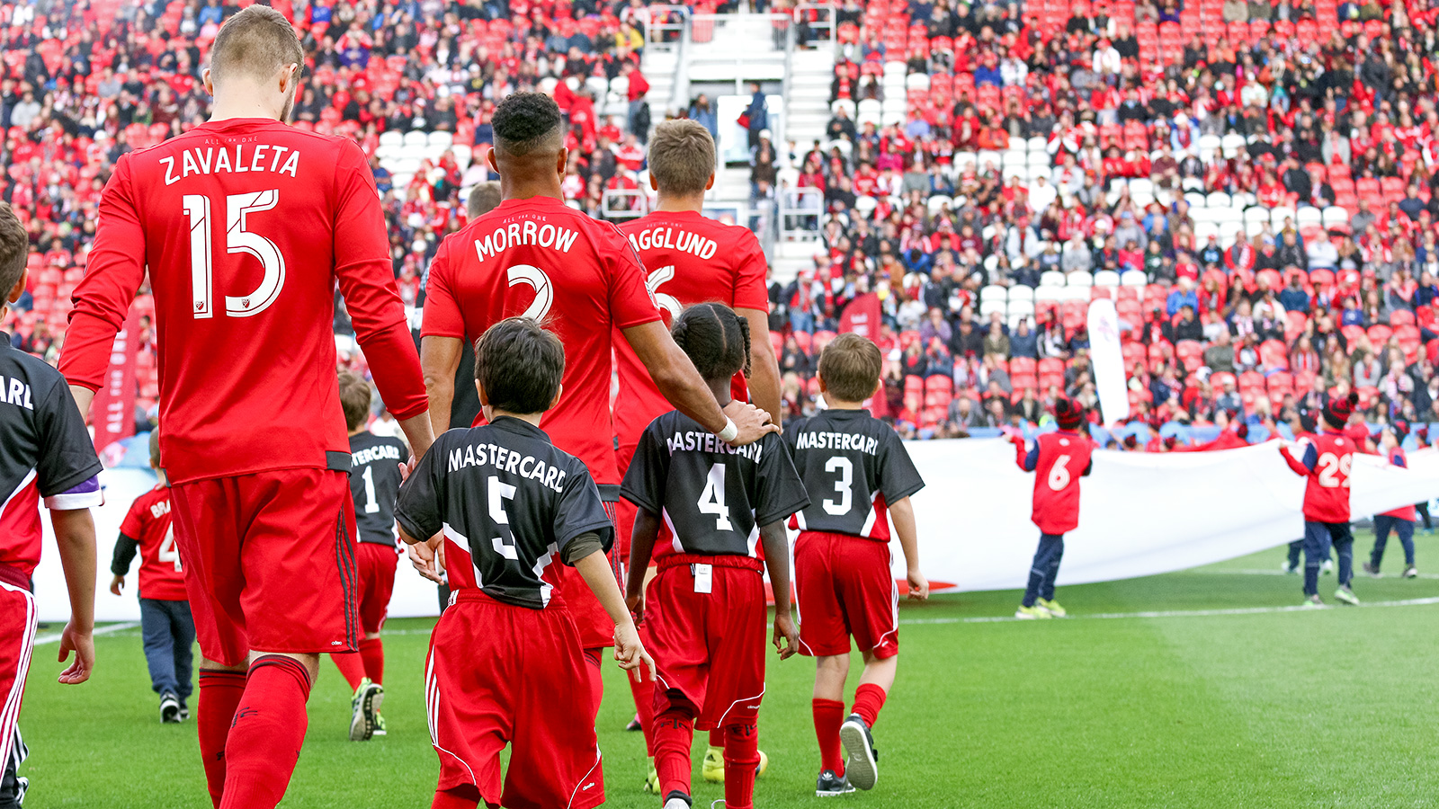 Players take to the pitch in the opening ceremonies.