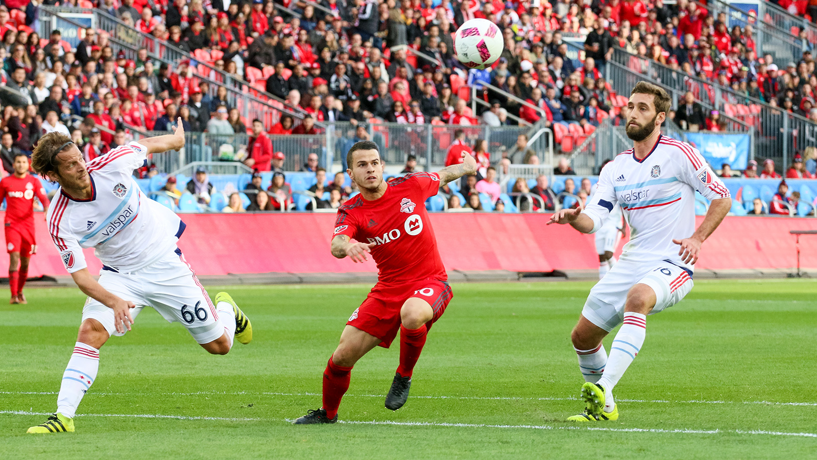 Toronto FC's Giovinco looking to keep the ball from two Chicago defenders.
