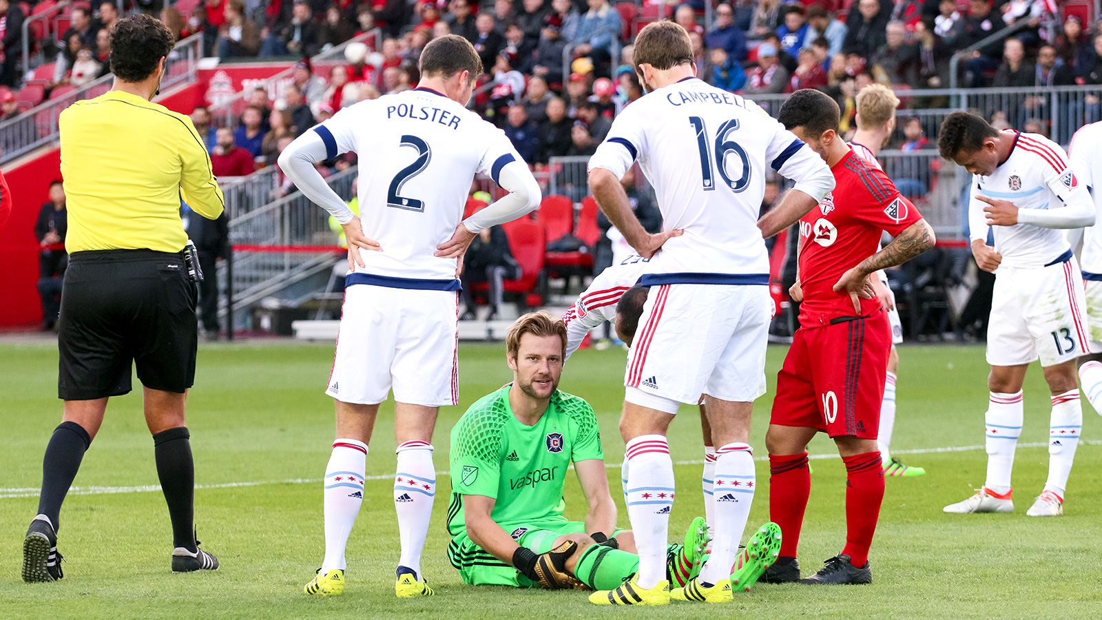 Chicago Fire Goalkeeper Patrick McLain stares down the photographer while waiting to receive medical treatment.