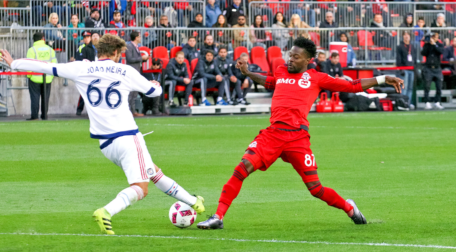 Ricketts and Meira battling for the ball in front of Chicago's goal.