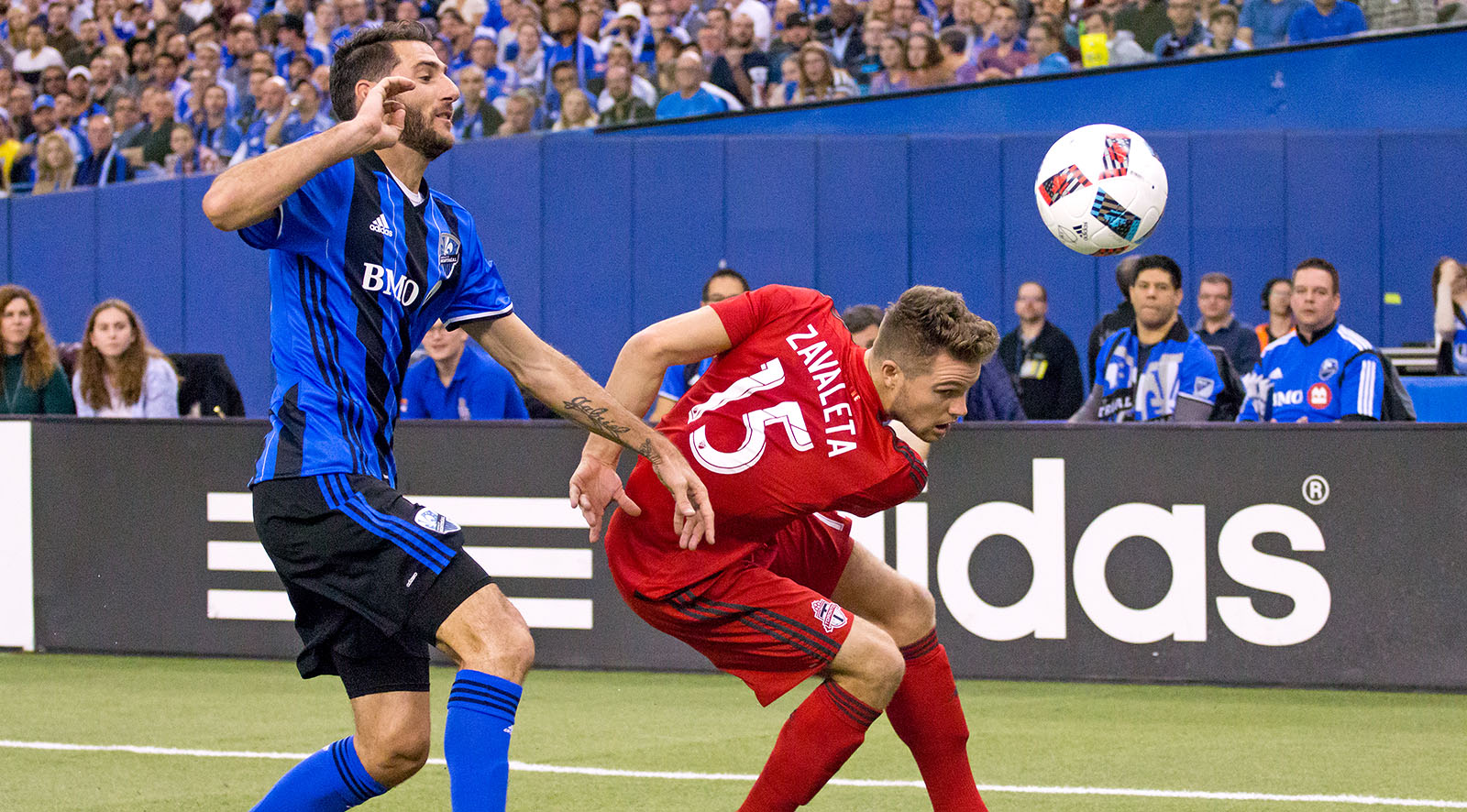 Eriq Zavaleta playing the ball away from a Montreal Impact forward during a 2016 MLS cup playoff game. Photo by Dennis Marciniak of denMAR Media.