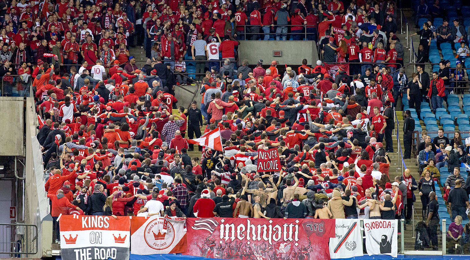 Toronto FC supporters make the trip out to support their team during the 2016 MLS Cup Playoffs. Image by Dennis Marciniak of denMAR Media.